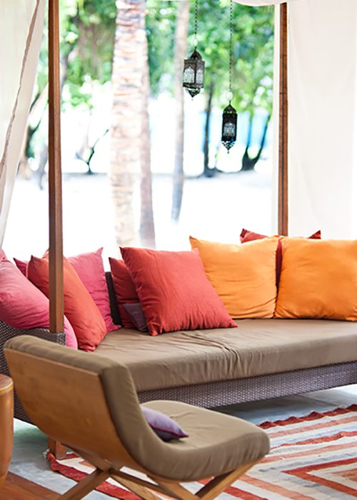 colorful cushions on the outdoor couch in maldives island resort; Shutterstock ID 64059088; Purchase Order: -