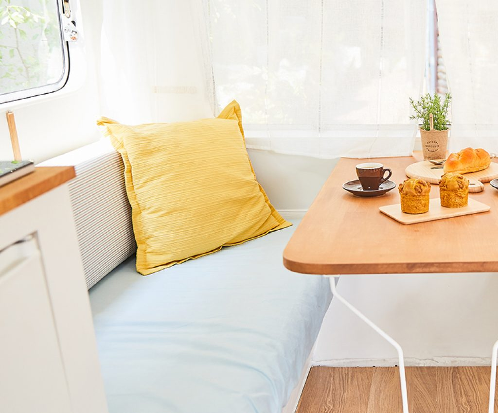 sofa and table in vintage caravan(retro design camper); Shutterstock ID 775122169; Purchase Order: -