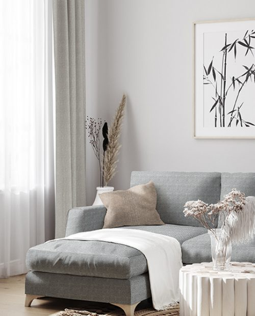 White sofa with decor and mockup frames on wall in Scandinavian style interior, 3d render; Shutterstock ID 1727816926; Purchase Order: -